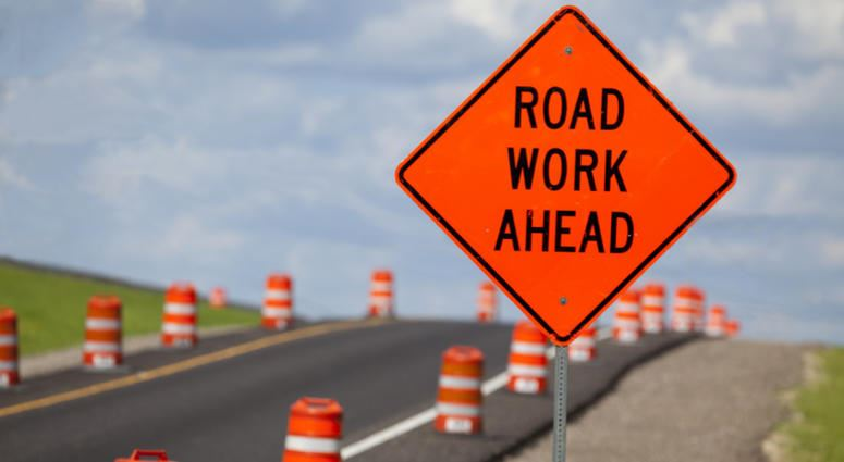 orange road work sign